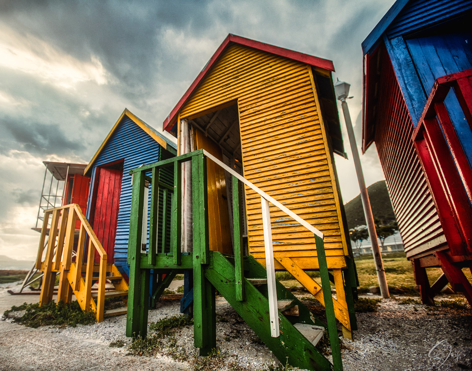 Colorful surf huts along St James beach
